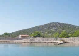 Maison de pêcheur Dario avec un petit bateau, île de Radelj